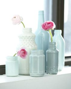 bottles ... with a little hobby acrylic paint coating the inside (make your own faux milkglass!)
