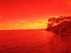 """Red landscape.  Looking through """"Total Internal Reflection"""" over Southern Moreton Bay and its Islands."""
