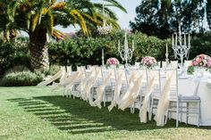 Cortijo Pedro Jimenez - banquet style dining, fabulous floral, candelabras with crystals, chiffon chairs backs. Photo courtesy of Agata Jensen Photography