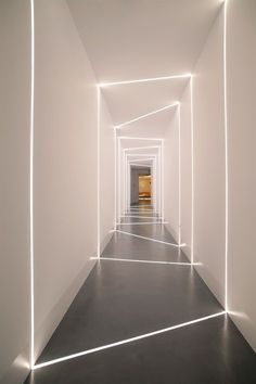 Isle on the Beiersdorf offices in Athens-Greece with led stripes incorporated into the concrete floor and drywall creating the effect of natural light entering through cuts on the wall. Design and implementation by the Love.it team.
