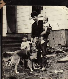 "Caption from the person in the Photo - ""Bolinas, CA, 1963.  That's Jane's brother, Hill; I'm holding Jane, and that was our dog, Rocco.  If I'd had any idea what a junk pile we lived in I surely would have attempted to clean it up for the picture because I remember thinking that the sailor shirt and pants from the Army and Navy store were pretty cool.