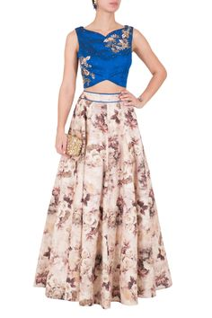 Criss cross blue top with floral skirt by Rianta's. Shop now: http://www.onceuponatrunk.com/designers/riyanta-s #blue #floral #embroidery #croptop #skirt #lehenga #shopnow #riantas #fashion #onceuponatrunk #happyshopping