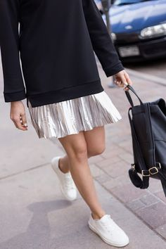 Athleisure done right! Metallic skirt with oversized sweatshirt and sneakers.