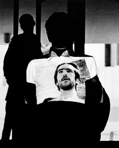 Intellettuale (Intellectual), performance documentation, 1975, showing Pier Paolo Pasolini's II Vangelo secondo Matteo (The Gospel According to Saint Matthew, 1964) projected on Pasolini  Fabio Mauri