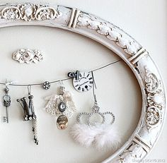 Creative way to repurpose an unused frame, organize your jewelry & create interesting wall art.