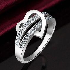 Stainless steel heart ,CZ diamond, sterling silver
