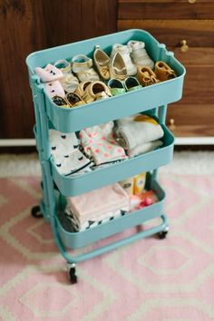 Ikea kitchen cart turned nursery organizer - great for storing baby shoes/clothes/blankets, making them easy to access. Would also make a great diaper station.