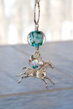 Tribal Appaloosa Horse Charm Necklace with gorgeous encased floral lampwork bead from Annie Divelbiss. Designed and created by Joann Hayssen Designs on Etsy, SRA - $45.00 - 20% of the purchase price will be donated to Rosemary Farm horse rescue and sanctuary!