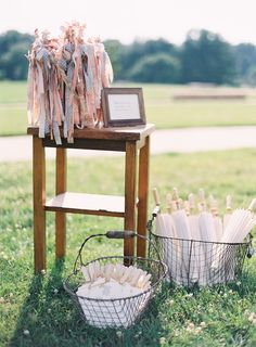 DIY Details: Ribbon Wands, Fan Programs + plus a few Parasols for the ladies' comfort   Photography: Clary Photo on SMP: http://www.stylemepretty.com/2013/12/02/st-louis-garden-wedding-from-clary-photo