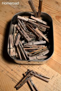 Age Clothespins. Fill container w/white vinegar and a steel wool pad. Let sit overnight. Drop clothespins into solution - make sure to coat each throroughly. Remove after a few minutes. Lay on rag to dry.