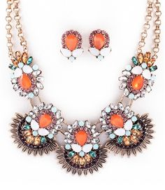 Coral glass statement necklace set. http://www.shoplauramichelle.net