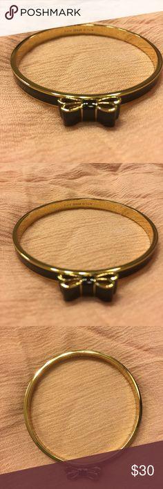 Kate Spade Black & Gold Bow Bangle Bracelet Kate Spade bangle bracelet. Black and gold w double bow detail. One size. kate spade Jewelry Bracelets