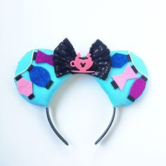 A personal favorite from my Etsy shop https://www.etsy.com/listing/256628139/disneyland-inspired-teacup-ride-ears-mad