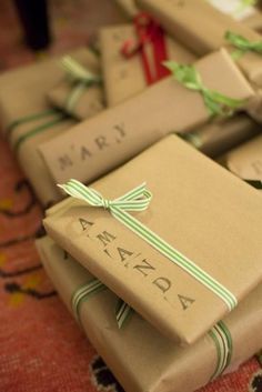 Stamps + Brown packing paper + ribbon makes for cute gift wrap :)