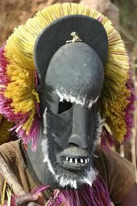PAST - The African mask is an ancient form of human art, religious worship and ceremonial costume. Most often made of leather, metal, fabric or types of wood, the mask has cultural and traditional significance within many of the native societies on the African continent. (Foster, B, 1999 to 2012)