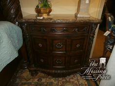 Ashley's nightstand with a serpentine shaped design and inlay stone veneer top. This collection takes traditional style to the next level. Measures 34*20*35. Two in store at time of posting. Arrived: Monday December 5th, 2016