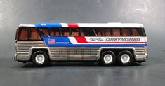 1979 Buddy L 4950 Americruiser Greyhound Bus Pressed Steel Toy Car Vehicle - Missing 2 Tires https://treasurevalleyantiques.com/products/1979-buddy-l-4950-americruiser-greyhound-bus-pressed-steel-toy-car-vehicle-missing-2-tires #Vintage #1970s #70s #Seventies #BuddyL #Americruiser #Greyhound #Bus #Buses #PressedSteel #Steel #Toys #Vehicles #Transporation #Travel #Tourism #Automobiles