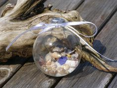 beach christmas decorations - Bing Images. Get clear bulbs at craft store then fill with tiny shell finds & lil sand: Cute for the tree