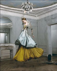 I can't decide which is more intense: her dress or the fact that she's swinging from a chandelier...