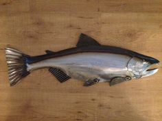This Salmon is great for your Lodge, Cottage, or Cabin theme.  - 30in Long  - Shipping in the US is $20.00  - All my sculptures are made of steel.Each piece is cut with a Plasma cutter by hand. I shape each sculpture with a Brass hammer and a block of wood. next they are welded, NO JIGS are used. After that I clean the sculpture and its ready for the finish.  - The finish on this Salmon is a Natural Steel with a Dark Patina along top . Its protected with 2 coats of a Interior/ Exterior ...