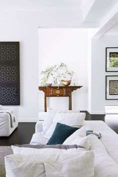 An antique Korean console delivers warmth in this monochrome space. Lantern screen panels from Eco Outdoor ǀ Australian House & Garden