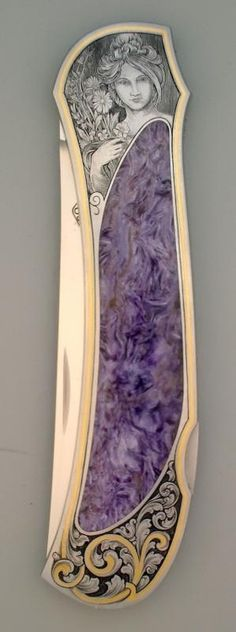 Gold & Purple Art Nouveau Pocket Knife features the face of a beautiful lady.