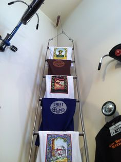 T-shirt display - use an emergency chain/rope ladder with a light stand