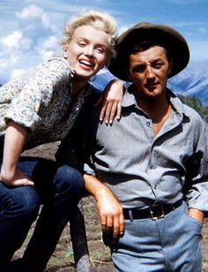 Marilyn Monroe and Robert Mitchum in Canada during the filming of River of No Return, 1953.