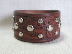 Hey, I found this really awesome Etsy listing at https://www.etsy.com/listing/221489552/leather-cuff-repurposed-upcycled-belt