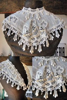 A French guipure lace collar or shawl or something. Look at the neat dangling fake pearls.