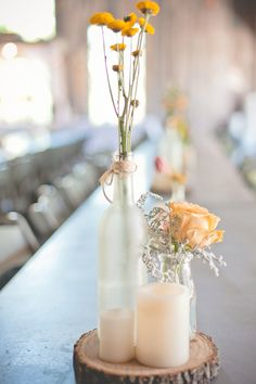 Simple Woodsy Wedding Centerpieces in Gray and Creamy Orange | Dust Studios | See More! http://heyweddinglady.com/handmade-and-homespun-country-wedding-from-dust-studios/