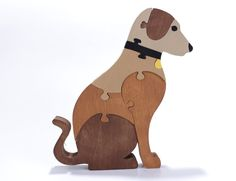 """This waldorf toy of a dog will not only surround your child with quality made natural toys, but, it will also inspire their imagination, problem solving skills and motor skills. This fun canine puzzle is a great game or room decoration for the dog lover in your family. It is made from ¾ inch thick hardwood plywood for added durability. The dog puzzle itself stands approximately 7"""" high and is about 6 ¼"""" wide. It is designed to stand on its own when completed, making it the perfect…"""