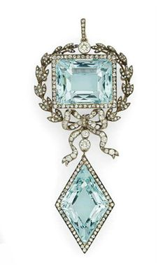 GOLD + SILVER-MOUNTED AQUAMARINE DIAMOND PENDANT BROOCH BY FABERGÉ, WITH THE WORKMASTER'S MARK OF AUGUST HOLLMING, ST PETERSBURG, 1899-1903, SCRATCHED INVENTORY NUMBER 76389 A rectangular-shaped aquamarine within silver-cast laurel wreath surmounted with rose-cut diamond and tied with ribbon, suspending an aquamarine within a gold-mounted diamond border, with suspension loop, in the original case stamped 'Fabergé St Petersburg Moscow, Odessa' #gold #silver #aquamarine #diamond #brooch…