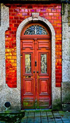 love the vibrant red oange color tones on this door; works pure magic with the green! Guimarães, Ave, Portugal