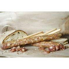 Nero Casertano pigs, wild-bred in Southern Lazio oak woods become refined sausages, embellished with fennel seeds - dried with patience in the shade of a natural cellar.