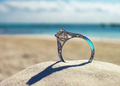beautiful shot of the ring on a beach. ... and that ring is awesome.