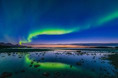 The northern lights dance over a Norwegian sunset in this National Geographic Your Shot Photo of the Day.