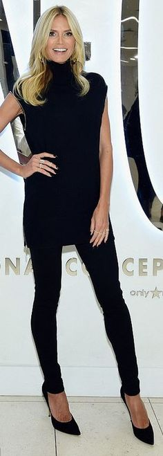 Who made Heidi Klum's black tunic sweater and suede pumps?