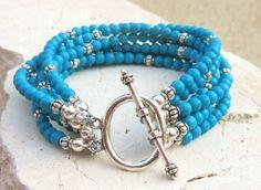 Turquoise Bracelet. Blue Chalk Turquoise Bracelet. Six Strand Toggle Bracelet. Turquoise Jewelry. $38.00, via Etsy.