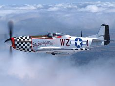 "North American P-51 Mustang fighters, ""Big Beautiful Doll"", Tail No. 472218."