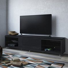 "Manhattan Comfort Lincoln 2.4 Series 94"" TV Stand in Black. Free Standing TV Stand for Living Room and Bedroom use. Upon Assembly, measures: 94.48 inches in Length, 21.22 inches in Height, 17.63 inches in Depth. Recommended for 80"" TV. No Mount Needed. Have your TV sit on a Classy and Contemporary Stand. Ample Storage Space with Media Holes for Wire Management."