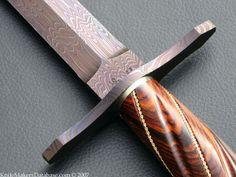"""Damascus & Gold Art Dagger by Rusty Polk, J.S. SPECS: Blade Length - 14 3/4"""" Overall Length - 10"""" Blade Steel - 1095 Carbon & 15n20 Nickel 300+ Layer Blued Hand Forged Damascus Fluted Cocobolo Wood Handle 14k Gold Rope Wrap Damascus Guard & Butt Cap Nickel Silver Spacers One-of-a-kind 100% Sole Authorship Ostrich Sheath w. Nickle Silver Throat"""