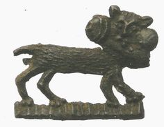 """cat with penis (not its own!) in mouth. lead badge found at Groede in the Netherlands, 1350x1400. 18mm high. scanned from Jos koldeweij, """"Geloof & Geluk"""" (Arnhem, 2006)"""