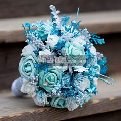 Frozen large bridal Disney themed winter wedding bouquet with silver, aqua and turquoise glitter accents  Get the perfect bouquet for your winter
