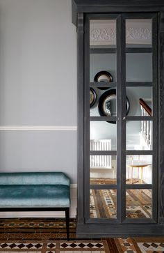 Edwardian hallway, original Edwardian tile, farrow and Ball wall colour blue. Hallway bespoke storage with mirrored doors reflecting circular mirrors on the opposite wall. Hallway bench in blue velvet Hallway Bench, Hallway Storage, Blue Hallway, Edwardian Hallway, Edwardian House, Self Build Houses, Circular Mirror, Hallway Designs, Mirror Door