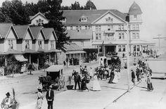 People strolling on the esplanade in Capitola. Hotel Capitola is the large building in the background. The Santa Cruz, Capitola and Watsonville electric streetcar line circled in front of the hotel.
