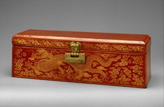 Sutra Box with Dragons amid Clouds. Ming dynasty (1368–1644), Yongle period (1403–24). China. H. 5 1/2 in. (14 cm); W. 5 in. (12.7 cm); L. 16 in. (40.6 cm; H. 2 3/4 in. (6.4 cm); Diam. 6 1/4 in. (15.9 cm). The Metropolitan Museum of Art, New York,  Purchase, Sir Joseph Hotung and The Vincent Astor Foundation Gifts, 2001 (2001.584a–c).  Photo: Courtesy of The Metropolitan Museum of Art.