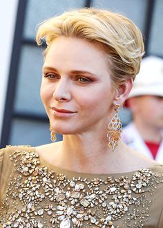 Princess Charlene debuted a new pair of chandelier earrings with orange stones from Graff on 15 June 2016. She had previously wore the same design with aquamarines back in 2013.
