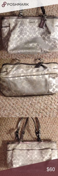 Authentic Coach Gray & Silver Shoulder Bag Cute Coach bag in good condition. Silver and gray with a purple lining. Great bag to have. No damage and a little sign of wear. Coach Bags Shoulder Bags