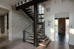 Exposed beam stairs in an industrial space   industrial home decor   home decor   industrial interiors